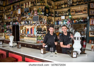 Andalusia, Spain - march 05, 2018: Waiters attending at the counter of a typical bar in the historic center of the city of Cadiz