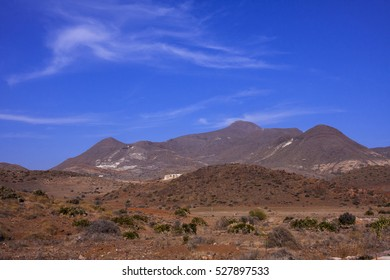 Andalusian landscape in the very south of Spain with an almost clear sky
