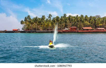 Andaman, India, March 23,2018: Female tourist enjoy water skiing near the beach at Ross island Andaman.