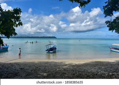 Andaman and Nicobar Island / India - Apr 15, 2019: Wide view of a tourist beach, Boats docked near the beach| tourists enjoying sea beach