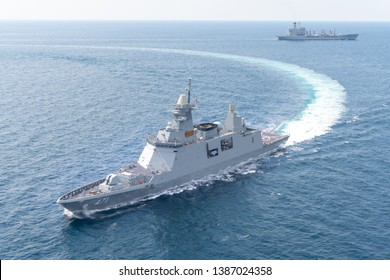ANDAMAN SEA, THAILAND - APRIL 9, 2019 : HTMS Bhumibol Adulyadej (FFG471) stealth frigate of Royal Thai Navy sails along with USNS Guadalupe (T-AO-200) underway replenishment oiler of U.S.Navy.