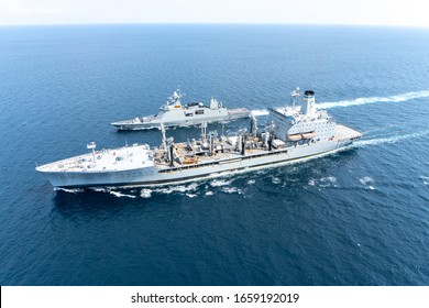 ANDAMAN SEA, THAILAND - APRIL 9, 2019 : HTMS Bhumibol Adulyadej (FFG471) Multi-role frigate of Royal Thai Navy sails along with USNS Guadalupe (T-AO-200) underway replenishment oiler of U.S.Navy.