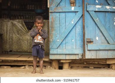 ANDASIBE, MADAGASCAR - SEPTEMBER 25 Children eating in front of local store on September 25, 2016, Andasibe National Park, Madagascar.