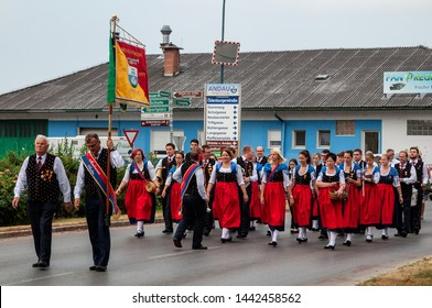 ANDAU/ AUSTRIA JUNE 19, 2019: brass-band in Andau, Burgenland, marching on corpus christi celebration day in their traditional costumes