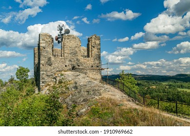 Andelska hora, Czech Republic - August 11 2018: The ruin of the stone castle with transmitter standing on a hill offering a scenic view into the countryside. Sunny summer day with blue sky and clouds.