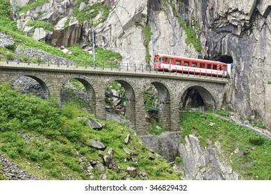 ANDERMATT, SWITZERLAND - June 21, 2015: The railroad bridge Teufelsbruecke - Devil's bridge.The Schollenen Gorge is an important route and the shortest transit to the St. Gotthard Pass.