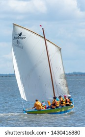 ANDERNOS, FRANCE - JUNE 15 2019: Every year in June, the traditional sailboats of the Arcachon Bay, like this one called Pinasse, gather in Andernos, near Cap Ferret, for a friendly regatta.