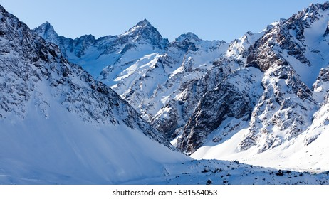 Andes mountain views around Portillo Chile ski resort on snowy sunny days.