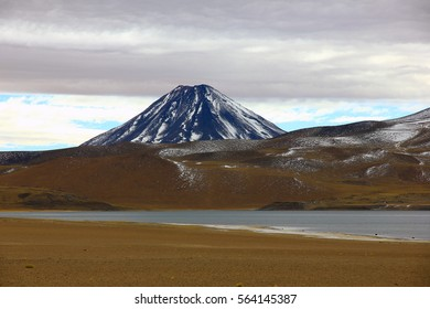 Andes mountains and volcanoes with snow top in Lauca national park. Nature landscape. Altiplanico, Atacama desert,Chile