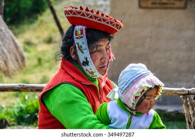 THE ANDES, PERU - JUNE 1, 2012: Quechua mother and baby in the mountains of The Andes over Ollantaytambo, Peru