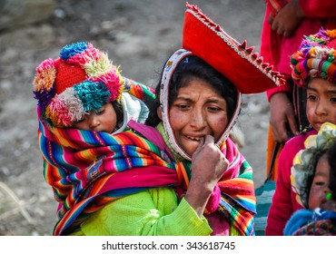THE ANDES, PERU - MAY 30, 2012: Quechua mother and baby in a village in the mountains of The Andes over Ollantaytambo, Peru