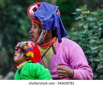 THE ANDES, PERU - MAY 30, 2012: Quechua mother and daughter in a village in the mountains of The Andes over Ollantaytambo, Peru