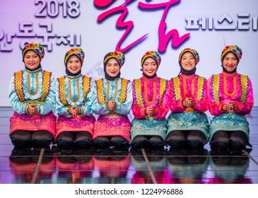 ANDONG , SOUTH KOREA - OCT 01 : Indonesian dancers performing the traditinal Ratoh Jaroe dance at the Mask dance festival in Andong South Korea on October 01 2018