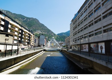 Andorra la Vella, Andorra - August 14, 2017: Andorra is the country with the smallest trade taxes. It is a tourist and commercial center of Europe. River with a monument of the city.