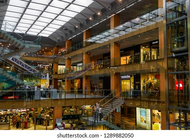 Andorra la Vella, Andorra - July 17 2017: illa Carlemany Shopping center. Interior of Centre Comercial Illa Carlemany mall with customers at 4 floors of commercial area establishments at Av. Carlemany