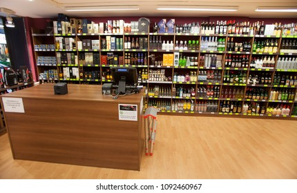 ANDORRA LA VELLA, ANDORRA. March 17, 2015: Shelves with countless bottles of wine in a wine shop in the city center of La Vella in Andorra. Payment counter desk cashier.