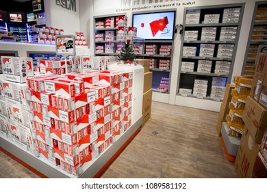 ANDORRA LA VELLA, ANDORRA. March 18, 2015: Store of cigarettes inside a shop in the city center of La Vella in Andorra. Display shelves of different types of cigarettes.