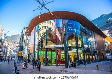 Andorra La Vieja, Andorra - Nov 5th 2017 - A big colorful store at Andorra downtown with tourists walking in the street in a late afternoon