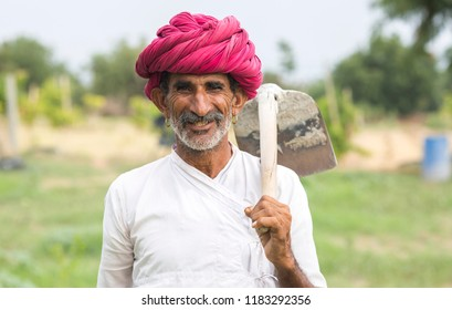 ANDOURE, INDIA-JULY 24: a rural man of rebari costom wearing colorful turban and casual and agree to pose at annual festival of rebari people comunity on July 24, 2016 Andoure, Rajasthan, india