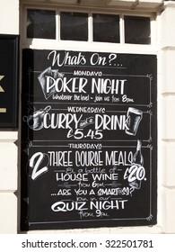 Andover, Bridge Street, Hampshire, England - September 25, 2015: White Hart Hotel events blackboard advertising poker night, curry and quiz night