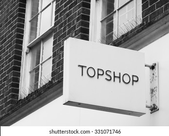 Andover, high Street, Hampshire, England - October 22, 2015: Topshop and Topman ladies and gentlemen high street fashion store sign over shop