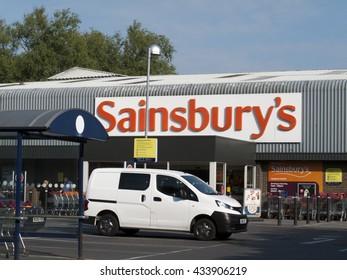 Andover, Shepherds Spring Lane, Hampshire, England - June 08, 2016: Sainsburys supermarket store entrance and car park