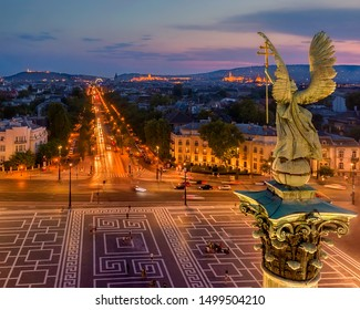 Andrassy street and Gabriel Arkangel in Budapest with city lights. Sunset mood.  Europe, Hungary, Heroes square