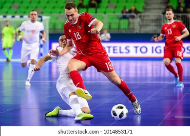 Andrei Afanasyev (R) of Russia vies with Artur Poplawski of Poland during the UEFA European Futsal Championship 2018 match between Russia and Poland at Arena Stozice in Ljubljana, Slovenia.