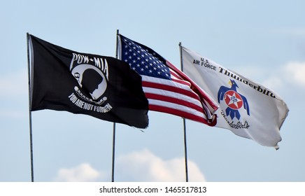 ANDREWS JOINT BASE, MD – SEPTEMBER 16: three flags flying at the Andrews Joint Base Air Show celebrating the 70th anniversary of the Air Force, on September 16, 2017.
