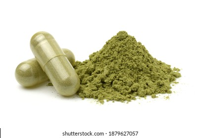 Andrographis Paniculata powder and capsules (Herbal capsules) isolated on a white background.