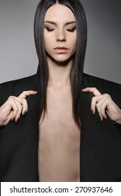 Androgynous beautiful young man as a beautiful woman with perfect makeup and glossy hair