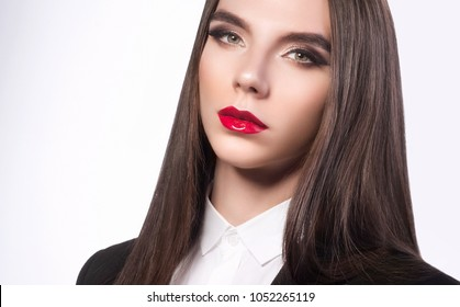 Androgynous young man as a beautiful woman with perfect skin makeup and glossy wet hair. High fashion look, glamour closeup portrait of sexy stylish brunette model with bright make-up and red lips