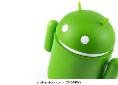 Android figure on the white background. Android is the operating system for smart phones, tablet computers, e-books, game consoles, and other devices. Ekaterinburg, Russia - October 15, 2017
