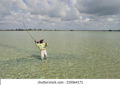 Andros Islands, Bahamas - May. 10. 2008:Fisherman casting for bonefish at the reef on Andros Islands, Bahamas, Caribbean Sea