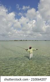 Andros Islands, Bahamas - May. 10. 2008:Fisherman casting for bonefish at the reef on Andros Islands, Bahamas, Caribbean Sea