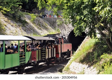 ANDUZE, FRANCE - JULY 14 : The steam locomotive tourist train from Anduze has started and has its installed in the car to go to Saint-Jean-du-Gard travelers, July 14, 2014.