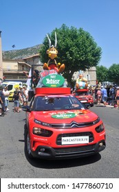 ANDUZE - FRANCE, JULY 23, 2019: Passage of an advertising car of Parc Asterix in the caravan of the Tour de France in Anduze