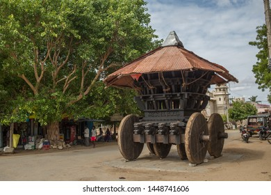 Anegundi, Karnataka / India - July 10 2019:  An ancient temple on wheels on a cloudy summer day in a small town in south India.