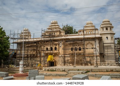 Anegundi, Karnataka / India - July 10 2019:  An ancient temple being renovated on a cloudy summer day in a small town in south India.