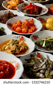 Aneka Masakan Padang. Popular dishes from a Padang eatery, served on layers of plate stacks.