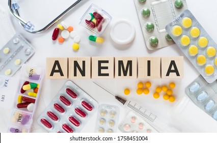 ANEMIA word written on building blocks. Pills and stethoscope background. Medical concept