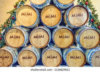 ANENII NOI, MOLDOVA - DECEMBER 16, 2017: Mimi Castle branded wine barrels with winter Christmas ornaments