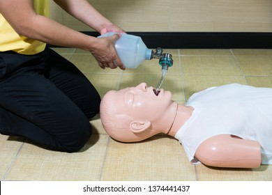 Anesthesiologist performing an orotracheal intubation on a simulation mannequin dummy during medical training to control of the airway. General Anesthesia. Medical manipulation.