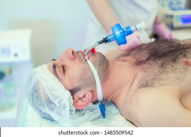 Anesthesiologist performing tracheal intubation in operation room. Preparation for surgery. Rhinoplasty