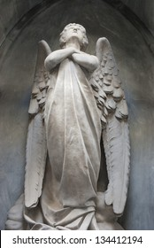 angel with arms crossed and head up