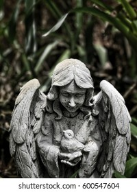 Angel with bird stone statue