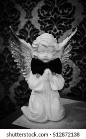 angel with bow of groom  prepare for wedding