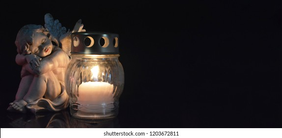Angel and burning candle