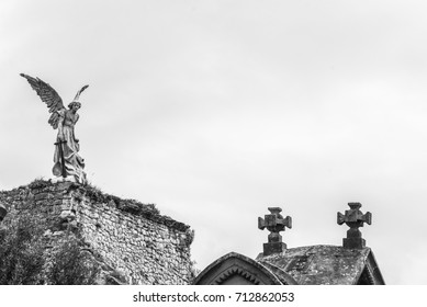 The Angel by Llimona (1895) towers above the cemetery of Comillas cemetery, Cantabria - Spain