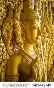 Angel Carvings Church Entrance. Thai arts Buddha statue.
